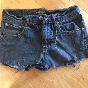 Carbon , blue jean shorts , distressed.